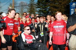 Uta with Dick and Rick Hoyt and the charity runners of the Hoyt Foundation before the 2012 Boston Marathon. ©www.PhotoRun.net