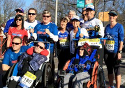 Bryan Lyons, Dick and Rick Hoyt with Uta and members of the Hoyt Foundation at the B.A.A. 5K on Saturday before the marathon. © www.PhotoRun.net